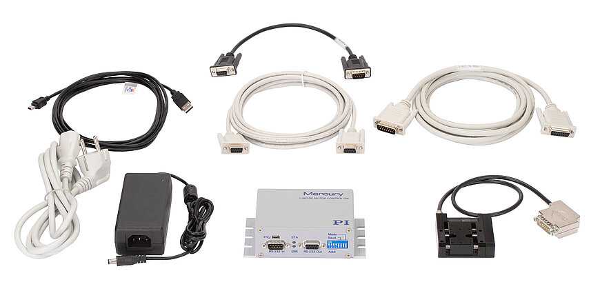 M-110.C86311 linear stage with C-863.11 controller, power adapter and power cord (front, from right to left), interface cables and daisy chain network cable (back)