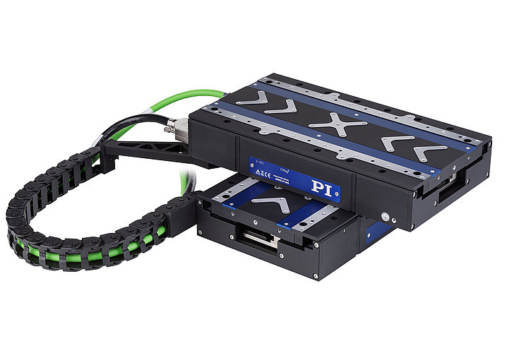 An XY setup of modified V-551.4D linear stages and an optional drag chain.