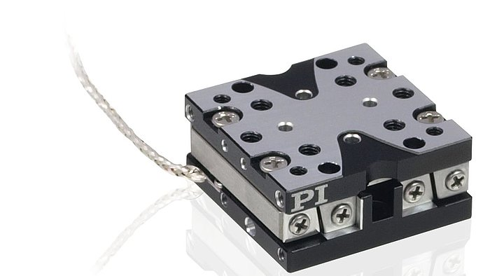 "The Q-522 series of economical mini positioning stages are equipped with a compact piezo stick-slop inertia motor. Featuring dimensions from 22x22x10mm, the Q-522 is one of the smallest precision linear stages available on the market, offered with travel ranges of 1/4"", 1/2"" and 1"".  The optimized piezo motor direct drive enables resolution up to 1 nanometer and velocity to 10 mm/second. Open-loop and encoder equipped versions are available. Q-522 stages can be combined with the Q-612 series of miniature rotary positioners. No adapter plates are required for mounting."