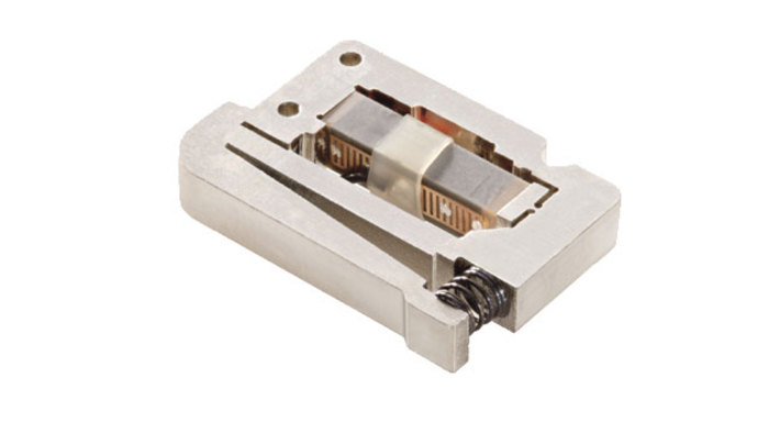 Flexure-guided and motion-amplified piezo ceramic actuators provide longer displacement ranges compared to piezo stacks in a more compact package. They are designed with protective preloads and several types of integrated flexure-guiding mechanisms are feasible depending on the guiding precision required in the application.