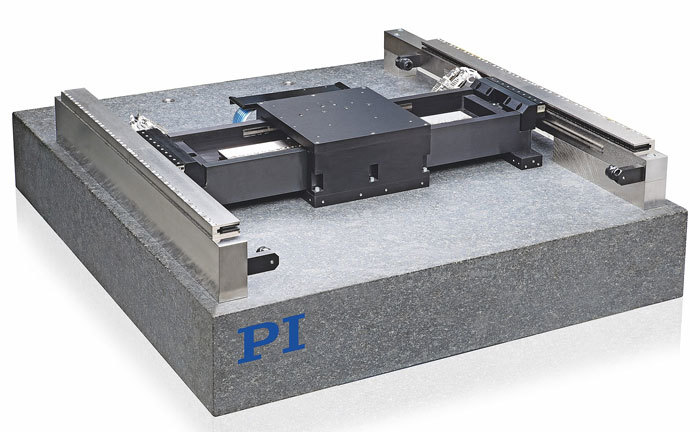 (left) A planar air bearing XY positioning stage with active yaw control for improved straightness of motion (Image: PI)