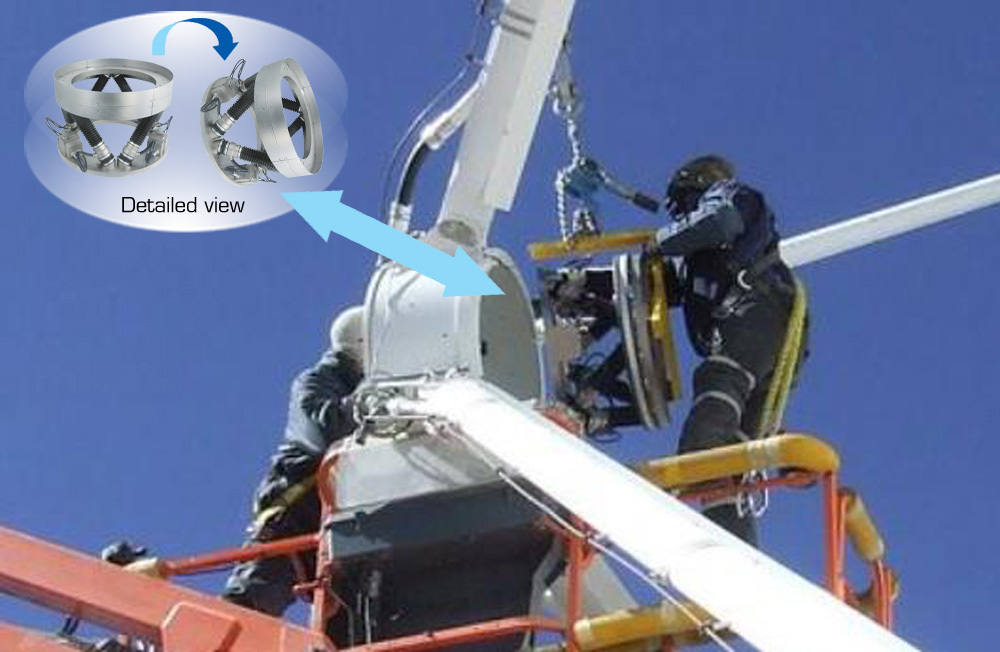 Engineers installing a PI Hexapod alignment system at a sub-reflector of an ALMA telescope. (Image: PI)