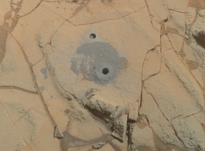 "Curiosity's drilling into a target called ""Mohave 2"" is visible surrounding the sample-collection hole in this January 31, 2015 image from the Rover's MAHLI camera. This site in the ""Pahrump Hills"" outcrop provided the mission's second drilled sample of Mars' Mount Sharp. (Image: NASA/JPL-Caltech/MSSS)"