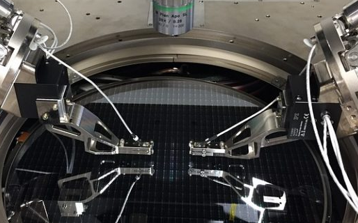 Silicon photonics, the latest craze in the semiconductor industry. Here two piezo XYZ scanners mounted on two hexapods speed up wafer level testing. (Image: Cascade Microtech, a FormFactor company)