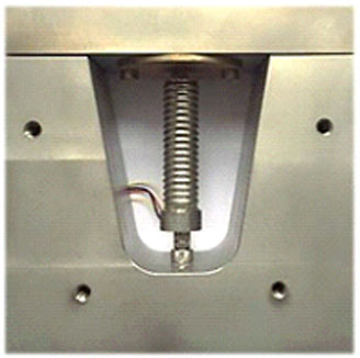 Fig. 8: Preloading frame for dynamic testing of PICMA® stack actuators. The threaded holes allow the addition of covers to test different cooling measures or remove convection cooling altogether.